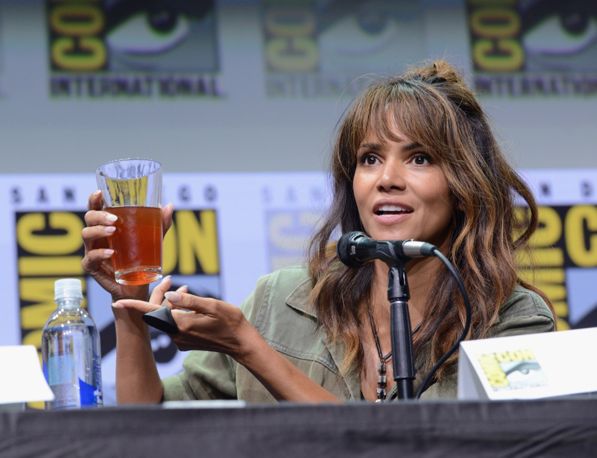 halle berry holding alcoholic drink onstage