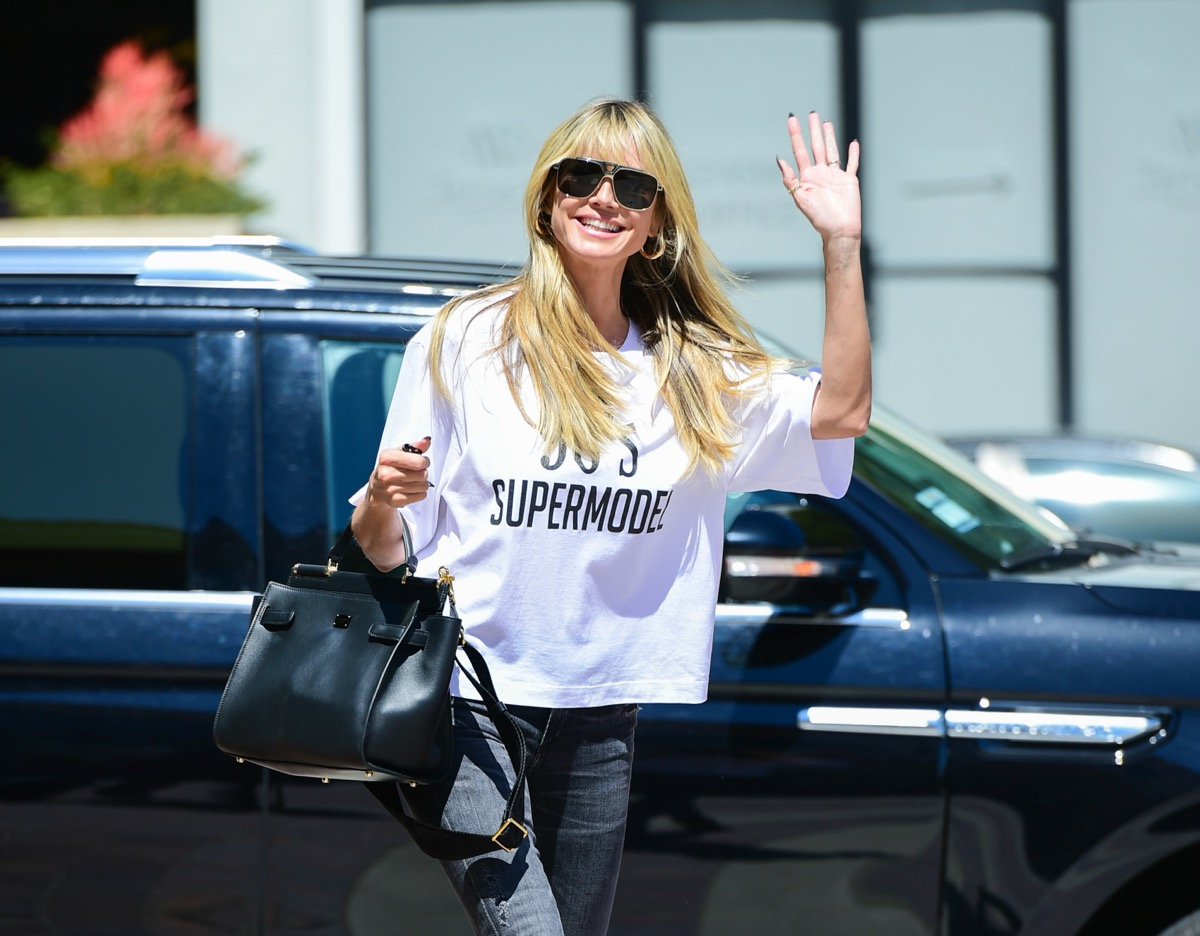 "heidi klum in white t-shirt reading ""90s supermodel"""