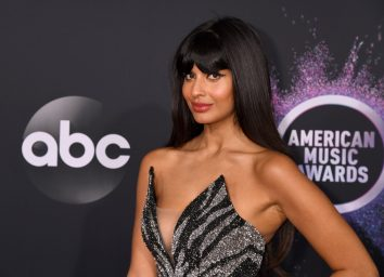 jameela jamil on red carpet in black and gray dress