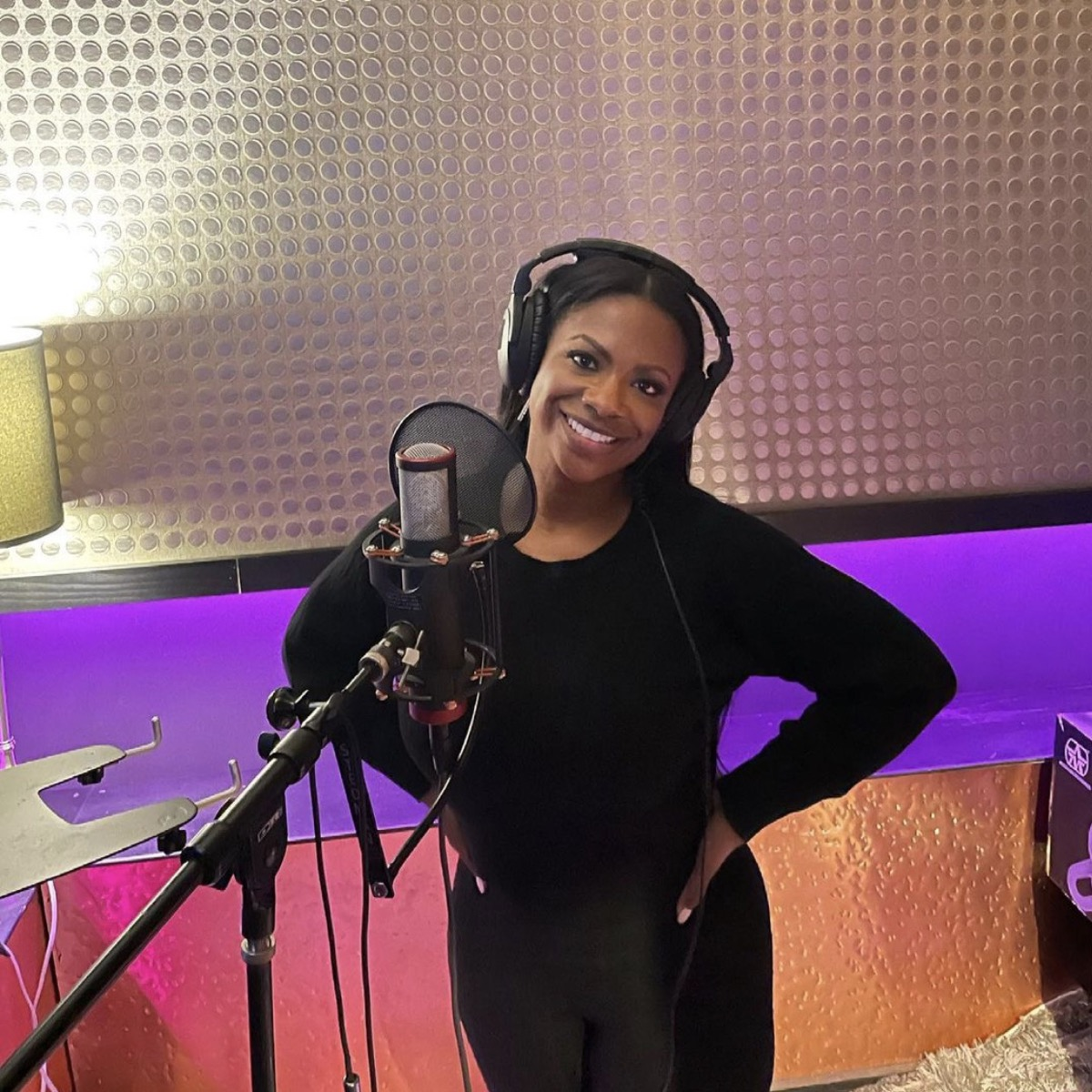 kandi burruss in black outfit in recording studio