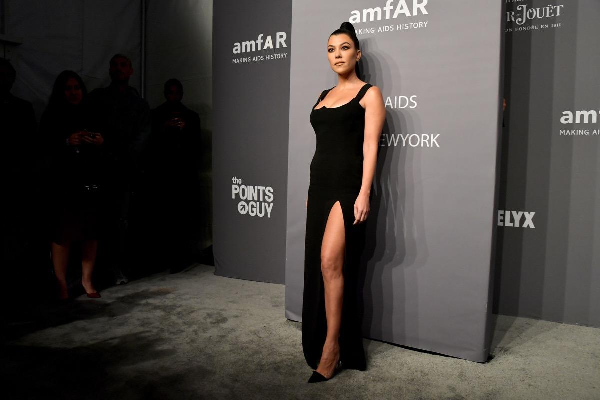 kourtney kardashian in black dress with high slit