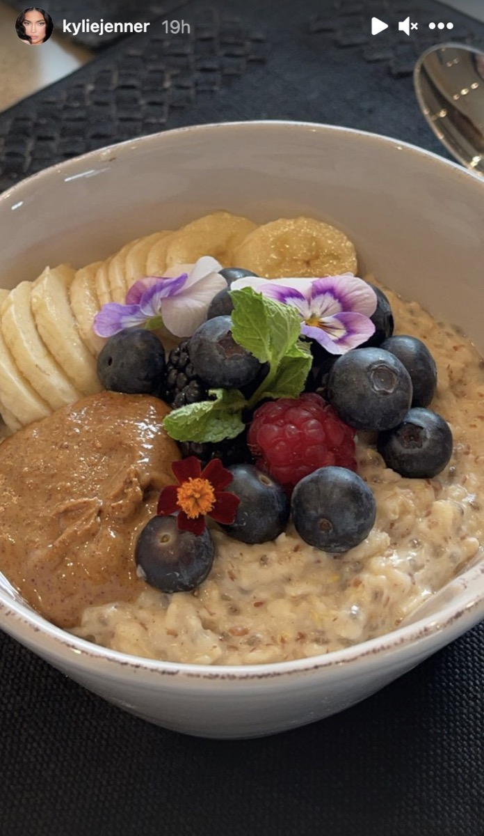 bowl of oatmeal with berries and flowers