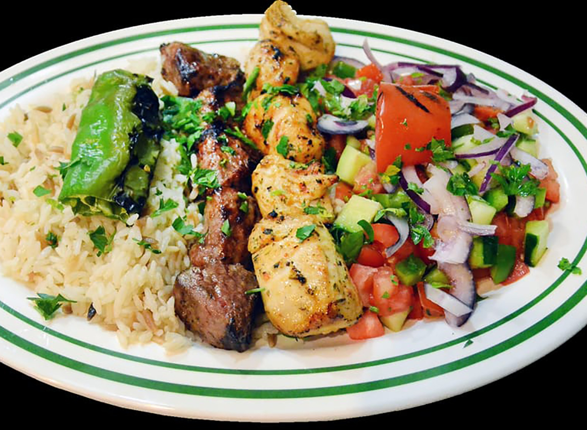 lamb and chicken kebabs with rice and vegetables