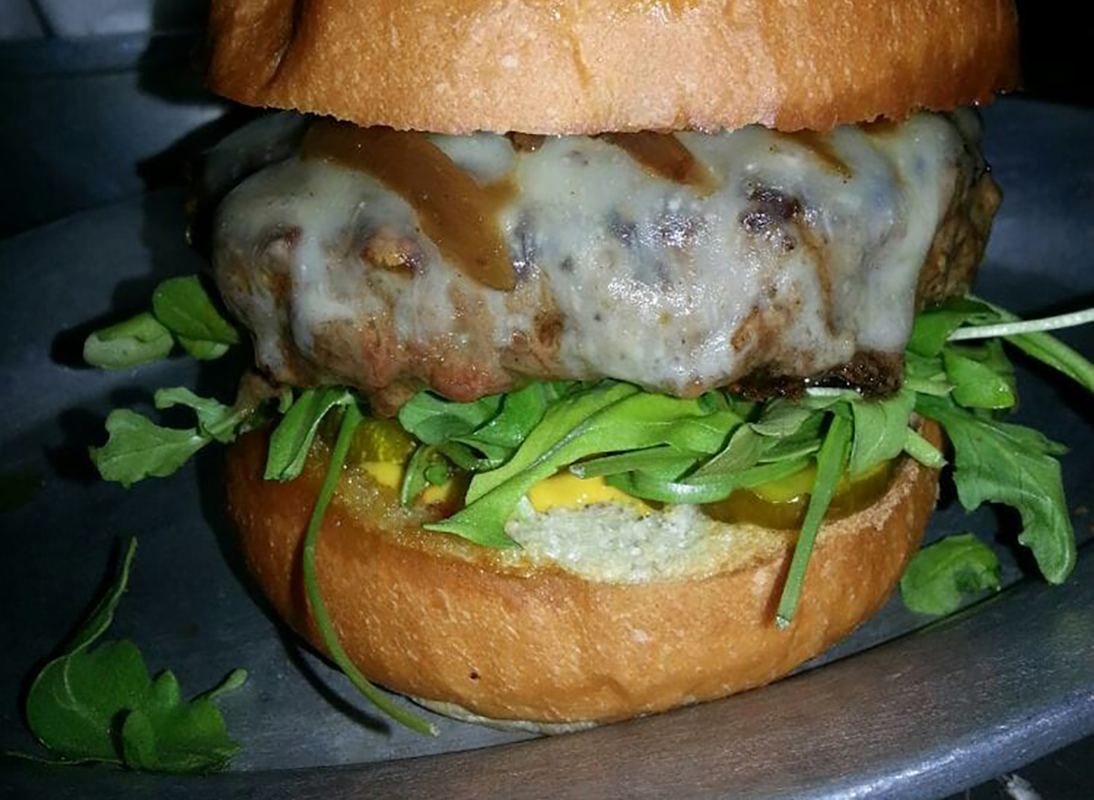 burger with cheese and arugula