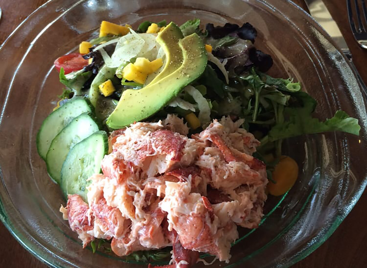 lobster salad in bowl with avocado slices