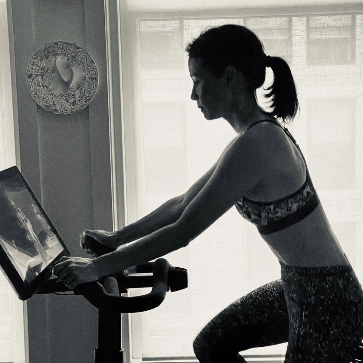 lucy liu in black and white photo on soulcycle or variis bike