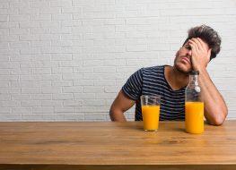 man with orange juice
