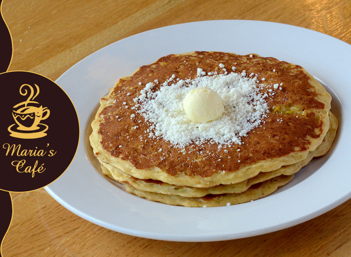 stack of pancakes topped with butter