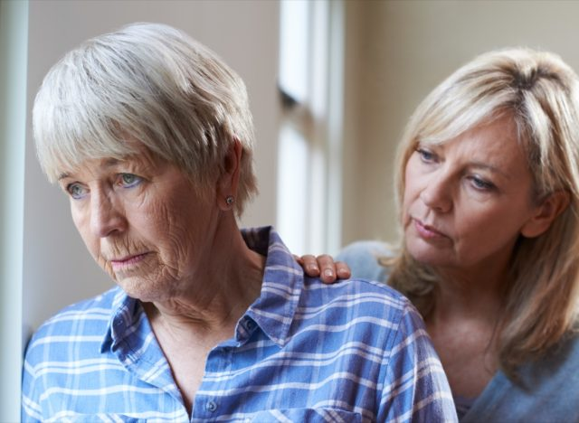senior woman with adult daughter at home.