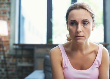 Worried mature woman at her home.