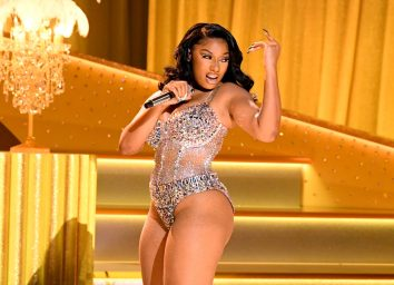 megan thee stallion dancing in jeweled leotard on stage at the grammys