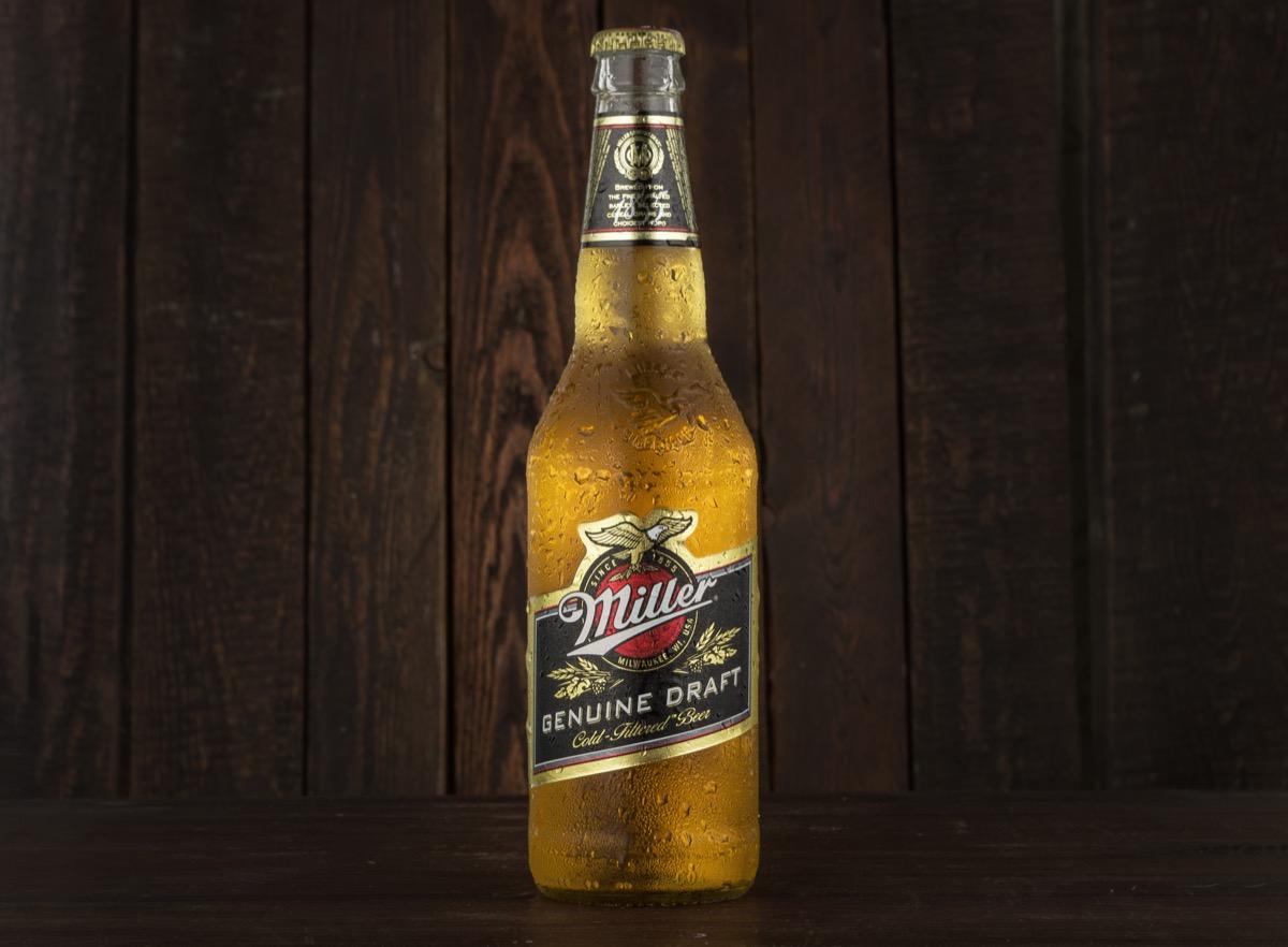 miller genuine draft beer against wood background