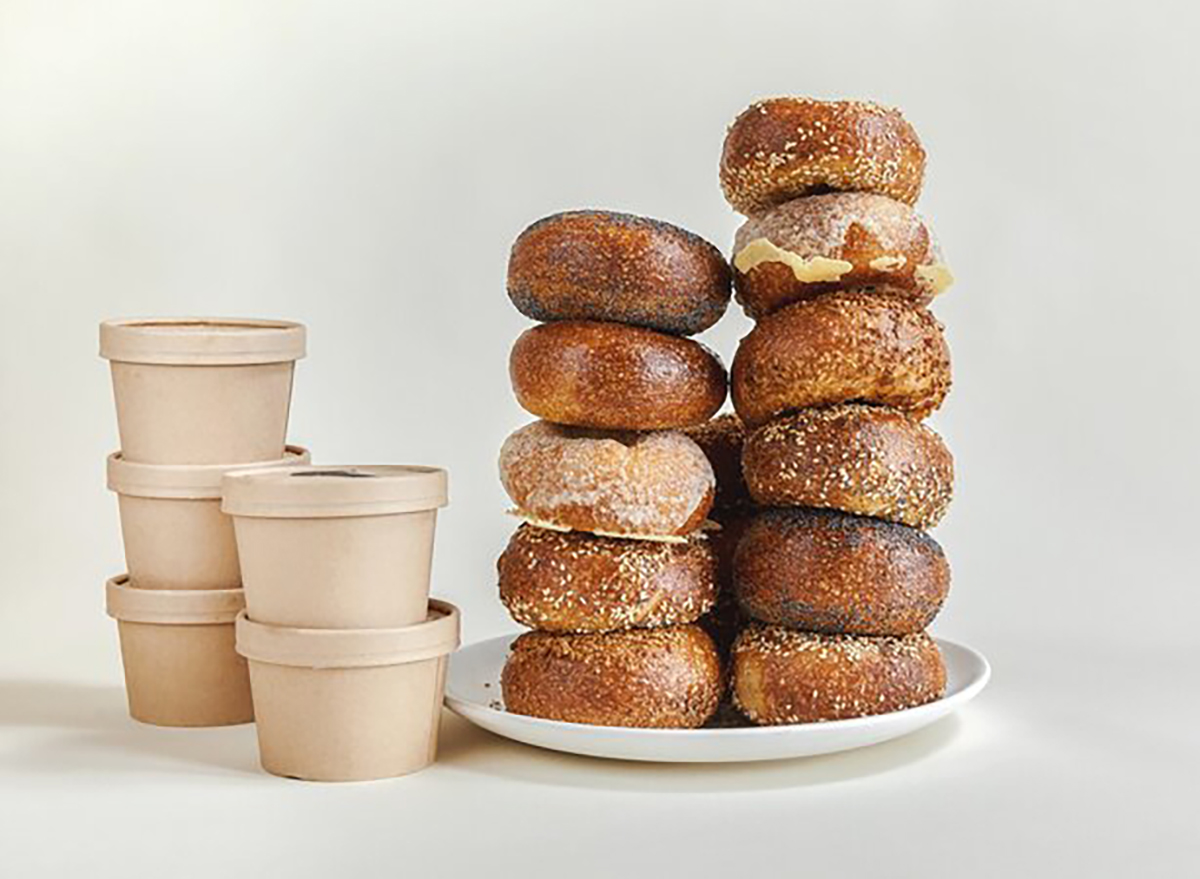 stack of bagels with tubs of cream cheese
