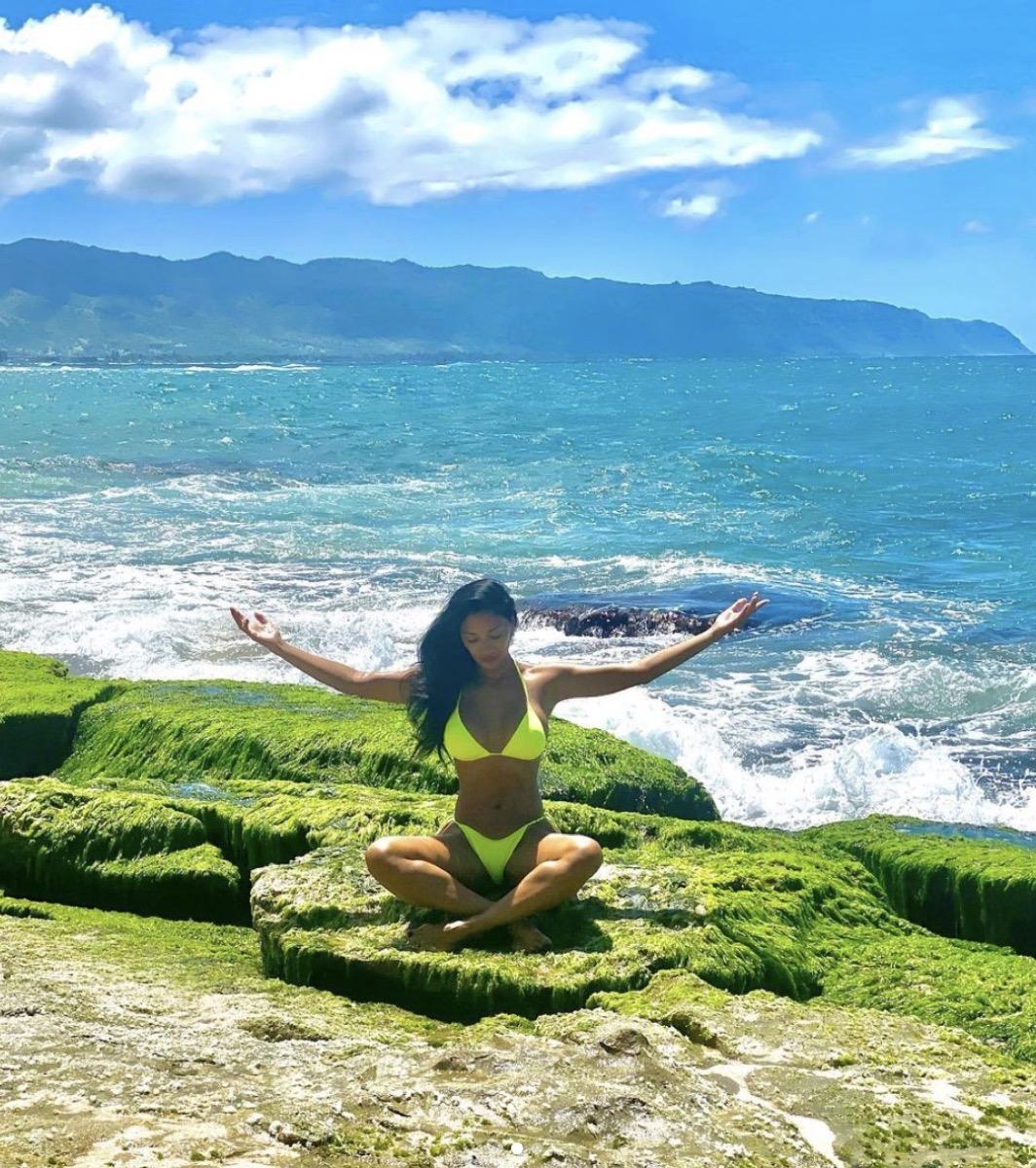 nicole scherzinger stretching in green bikini on beach