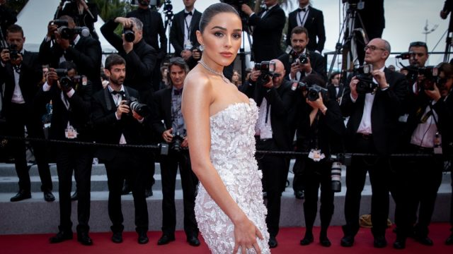 olivia culpo in white lace dress on red carpet