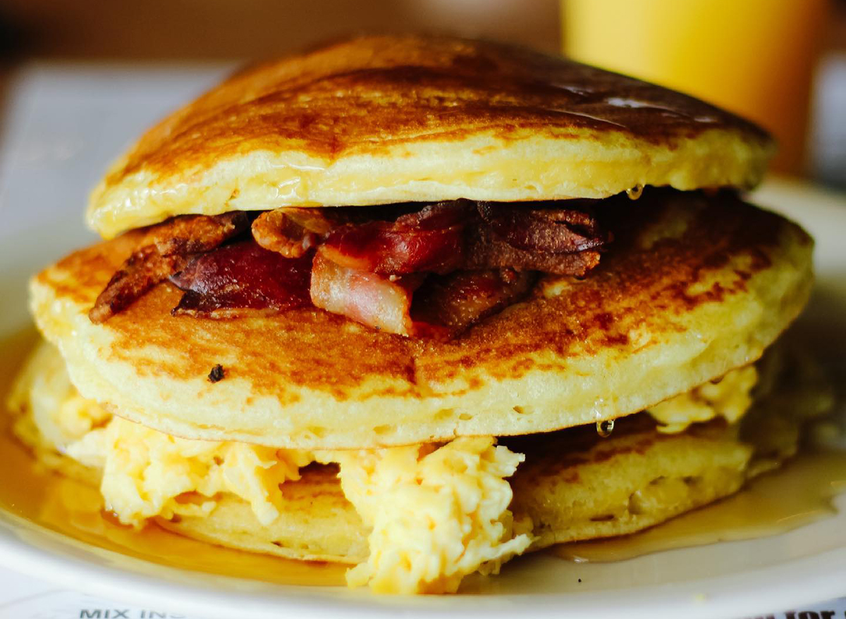 pancake sandwich with eggs and bacon