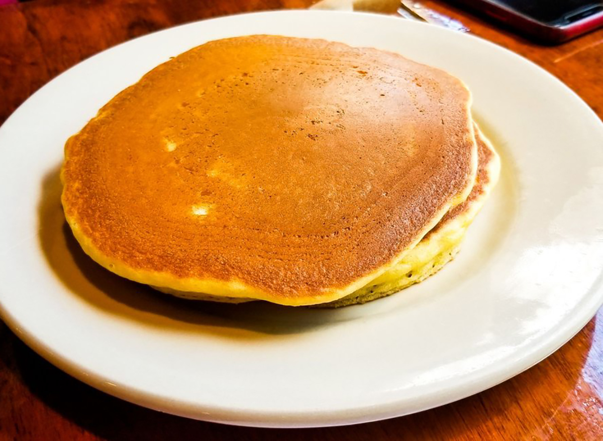 stack of two pancakes on a white plate