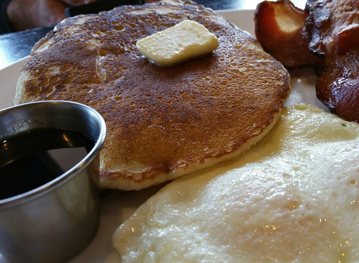 pancake with butter pat and fried egg