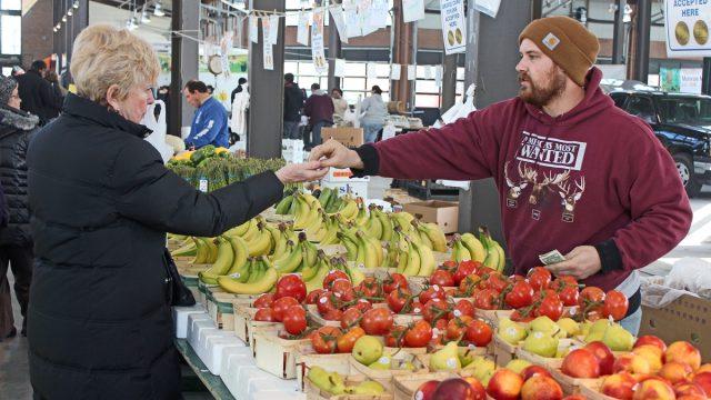 A vendor makes a sale at Detroit's Eastern Market