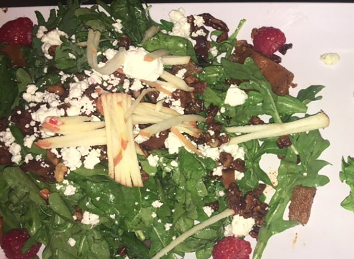 pink lady salad topped with apples and cheese