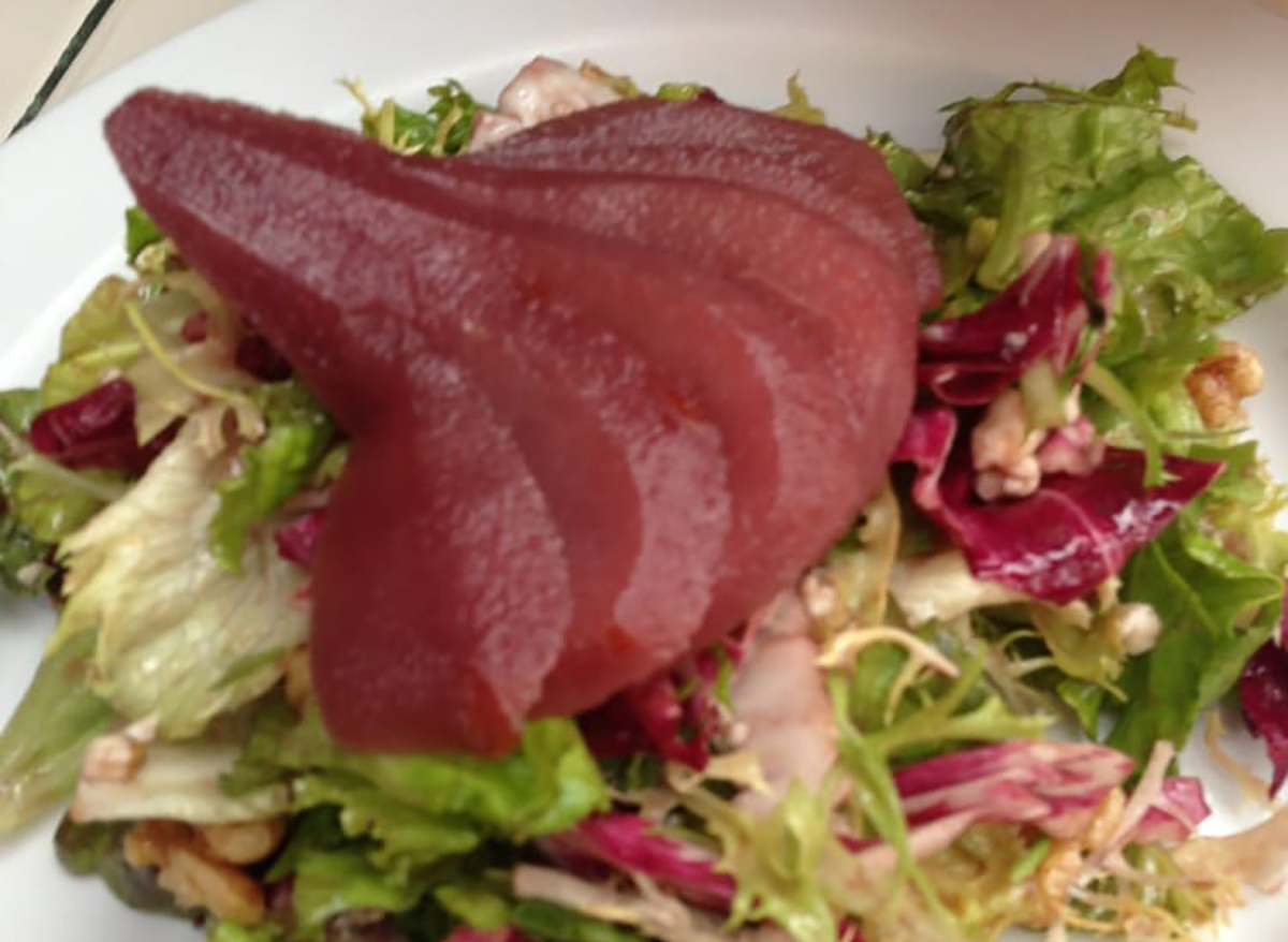 salad topped with poached pears
