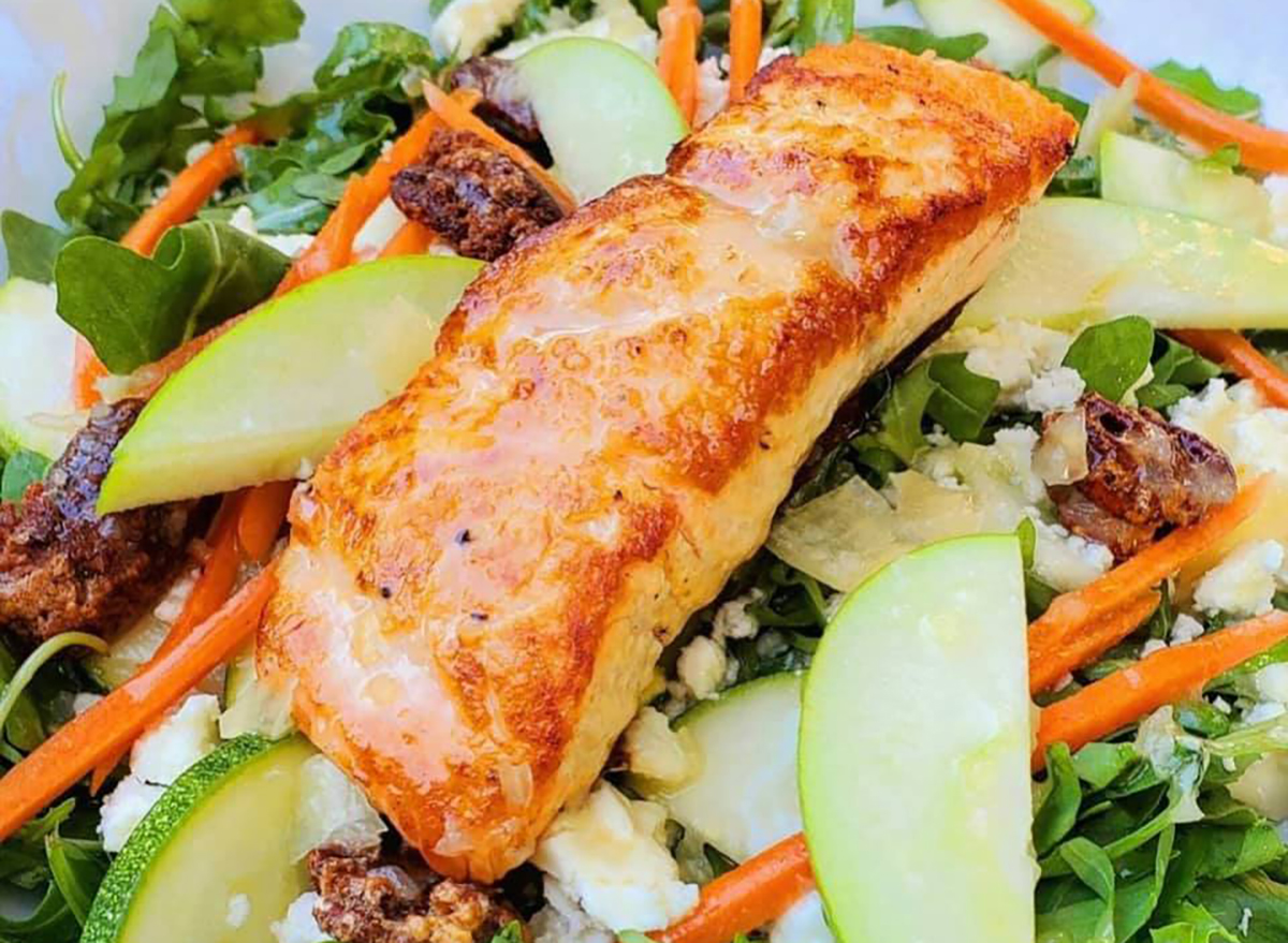 salad topped with salmon filet