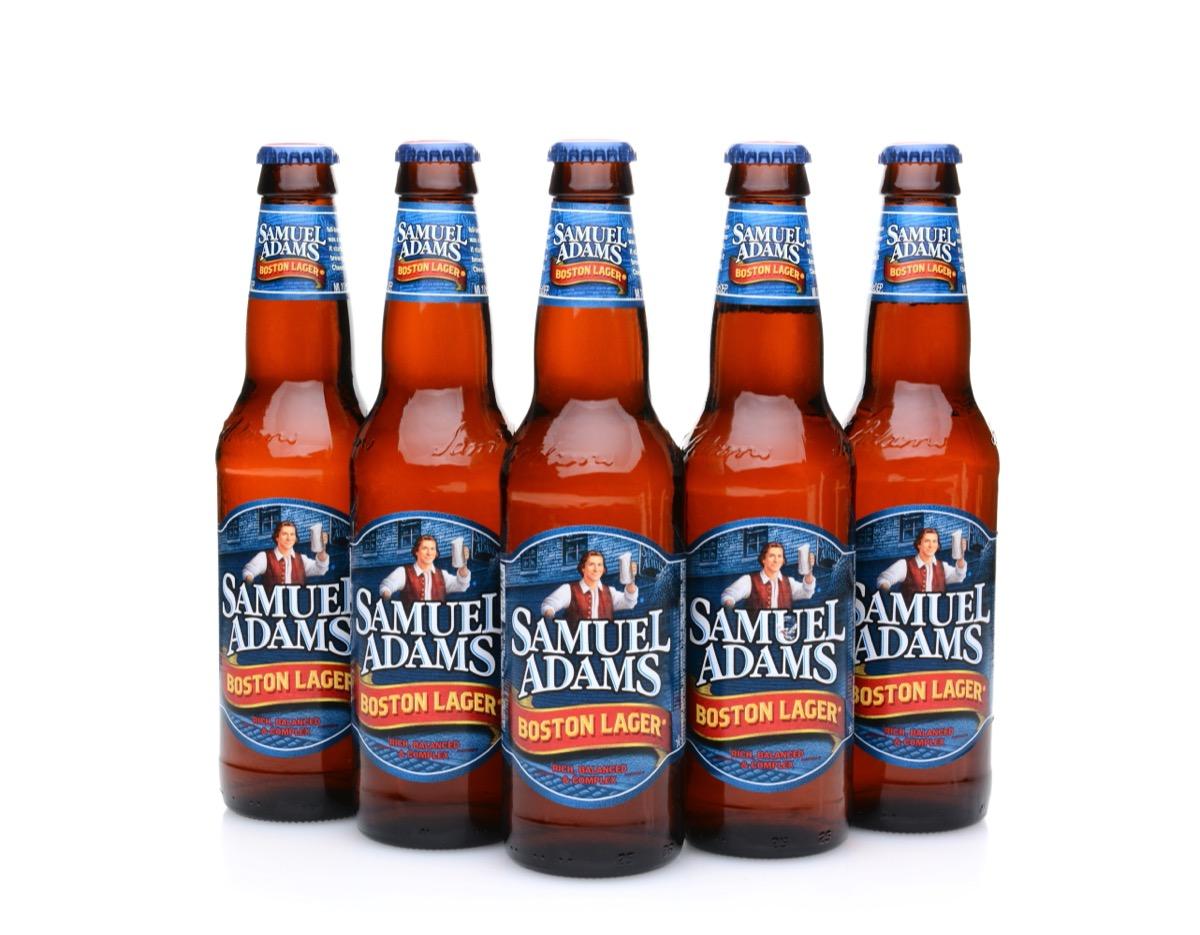 five bottles of sam adams boston lager on white background