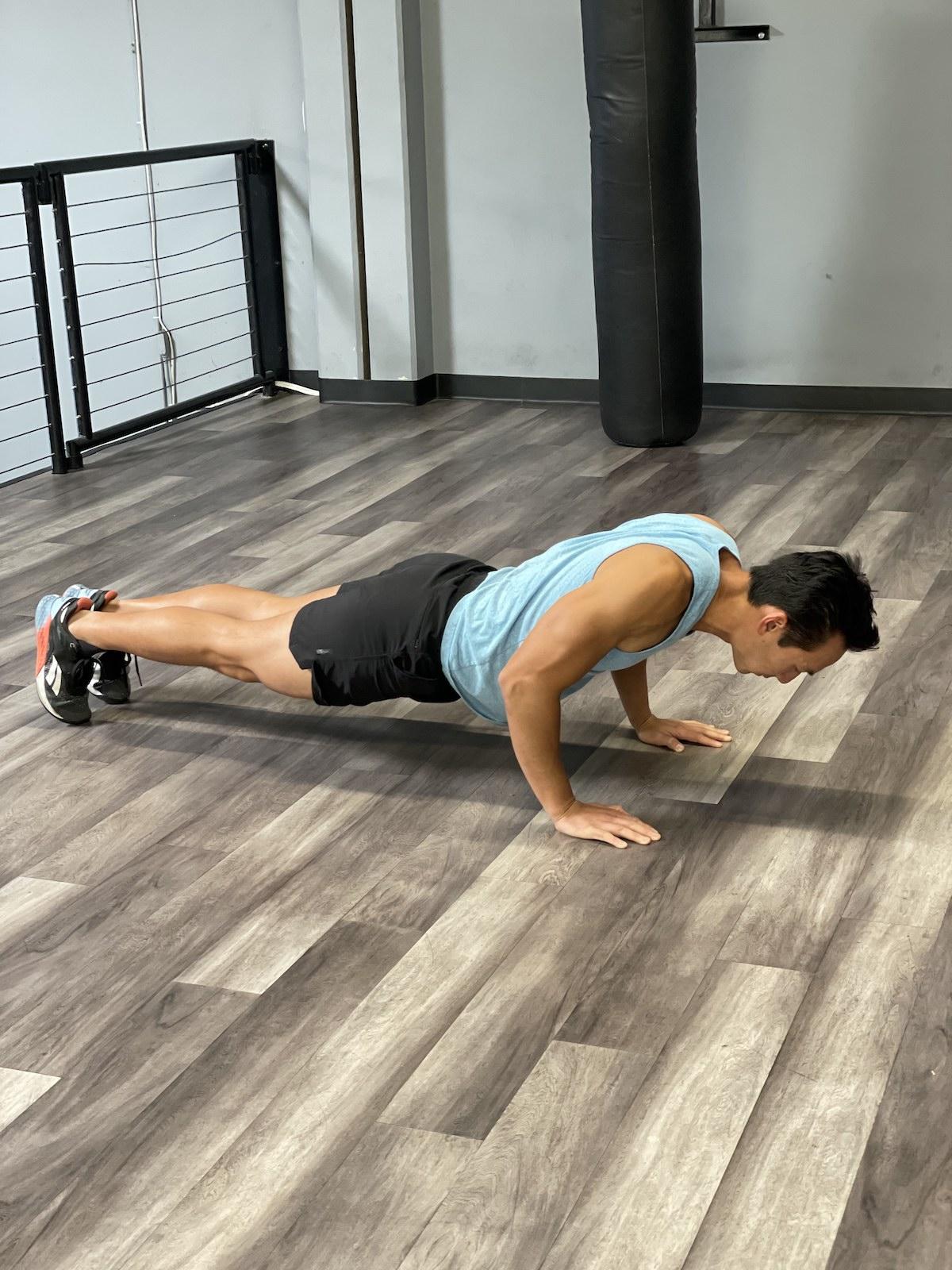 tim liu doing a pushup - poor form