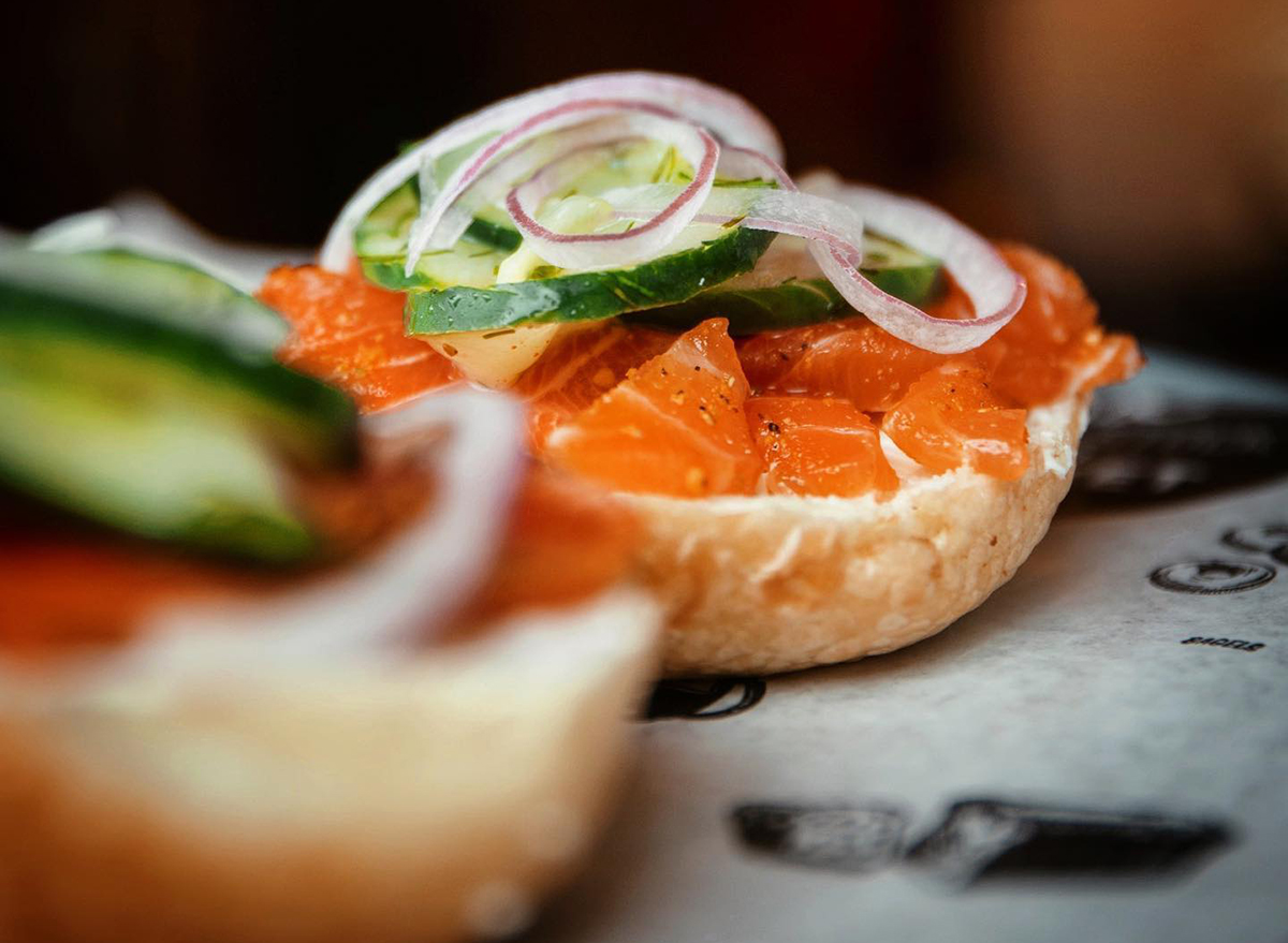 bagel topped with lox and vegetables
