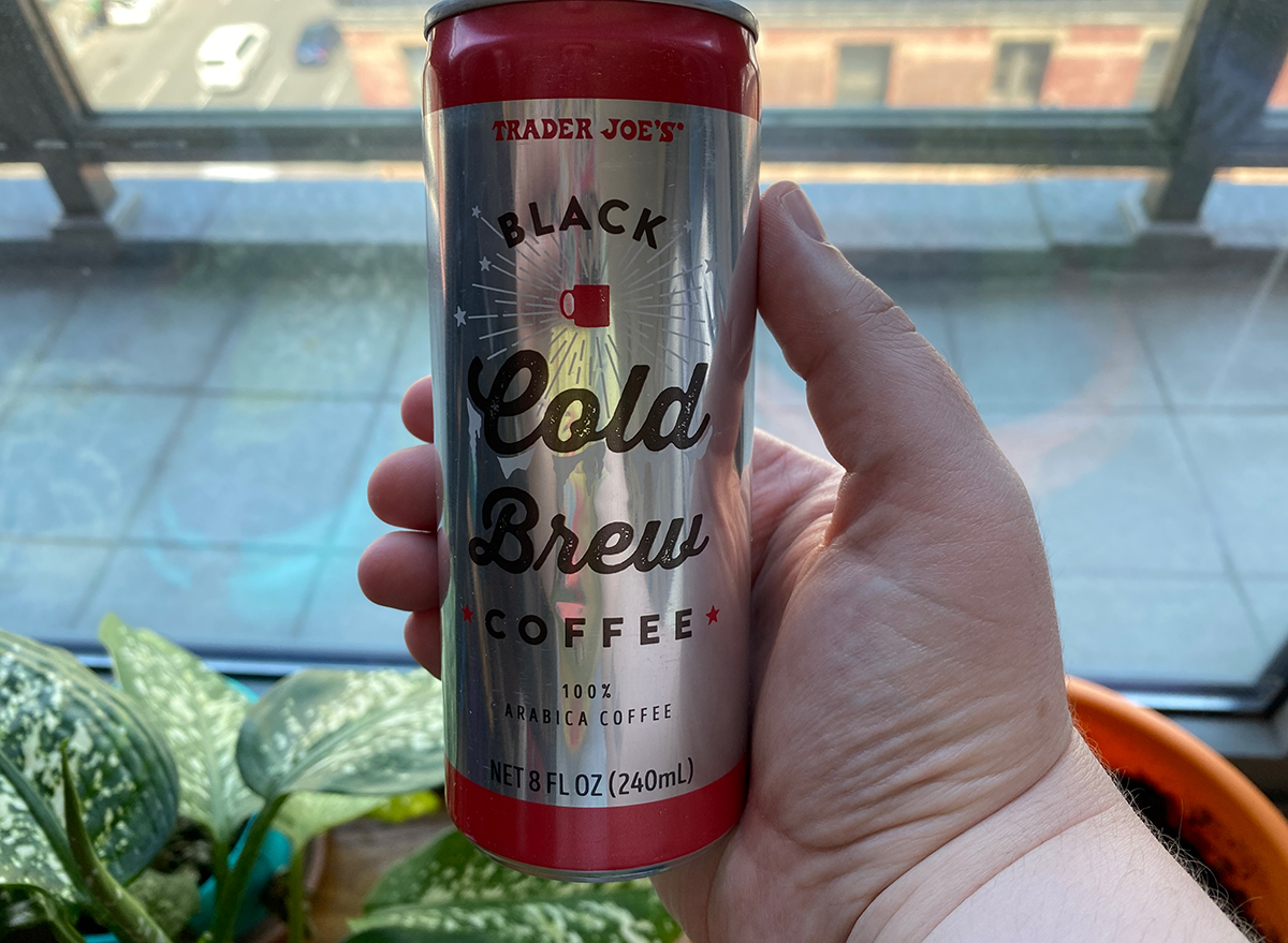 hand holding trader joes cold brew coffee can