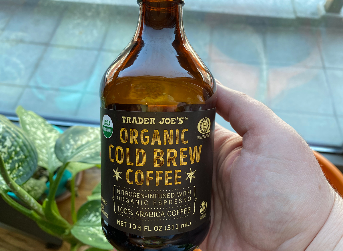 hand holding bottle of organic trader joes cold brew