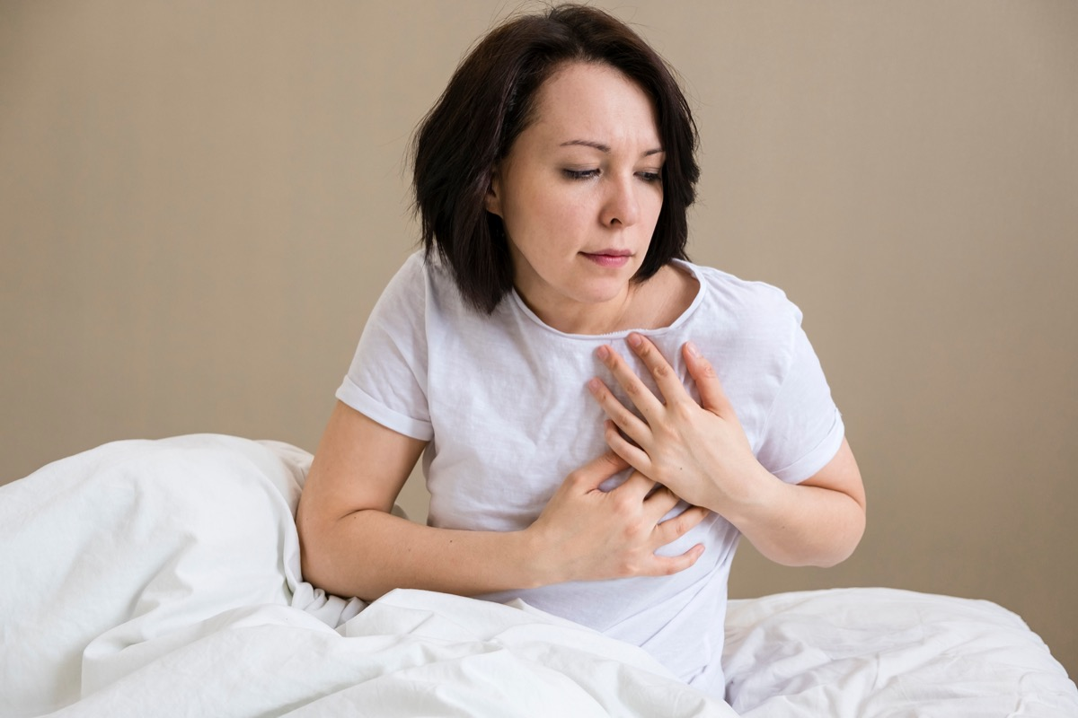 Woman is clutching her chest
