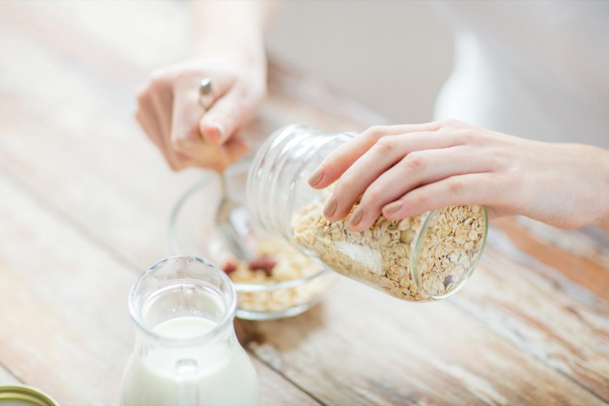 woman making oatmeal
