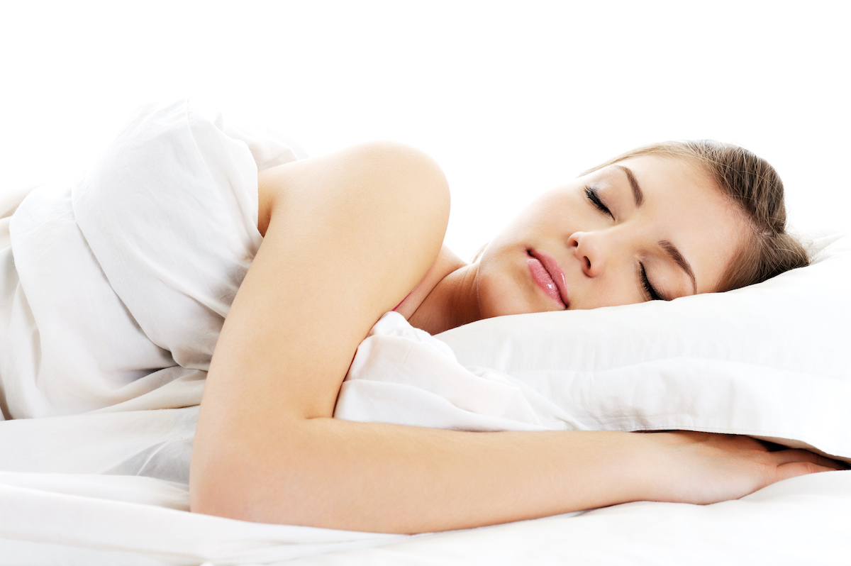 Front view portrait of beautiful resting woman cover white blanket