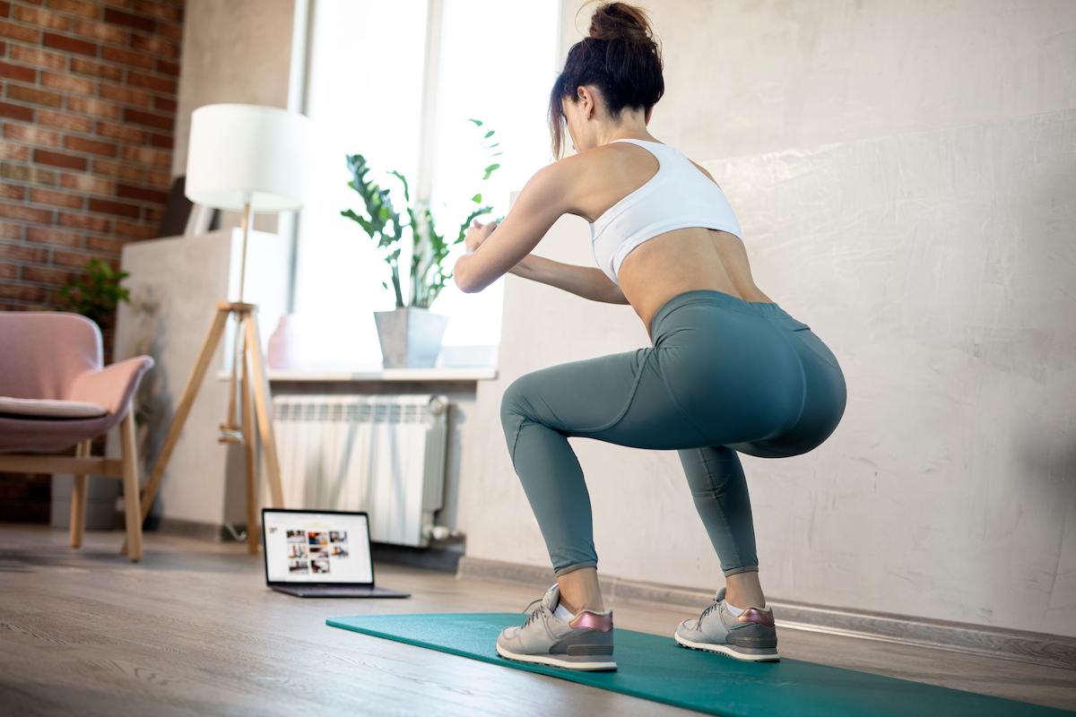 Young sporty slim woman coach internet video online fitness training instructor modern laptop screen. Healthy lifestyle concept, online fitness and sport lessons.