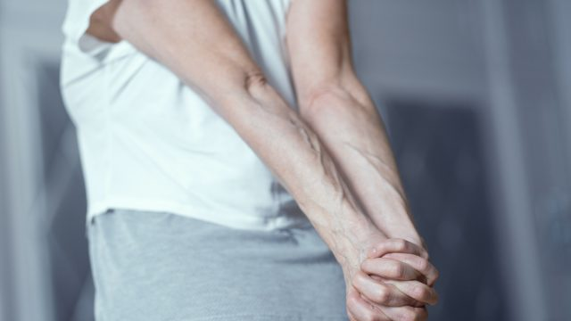 stretching hands behind lower back