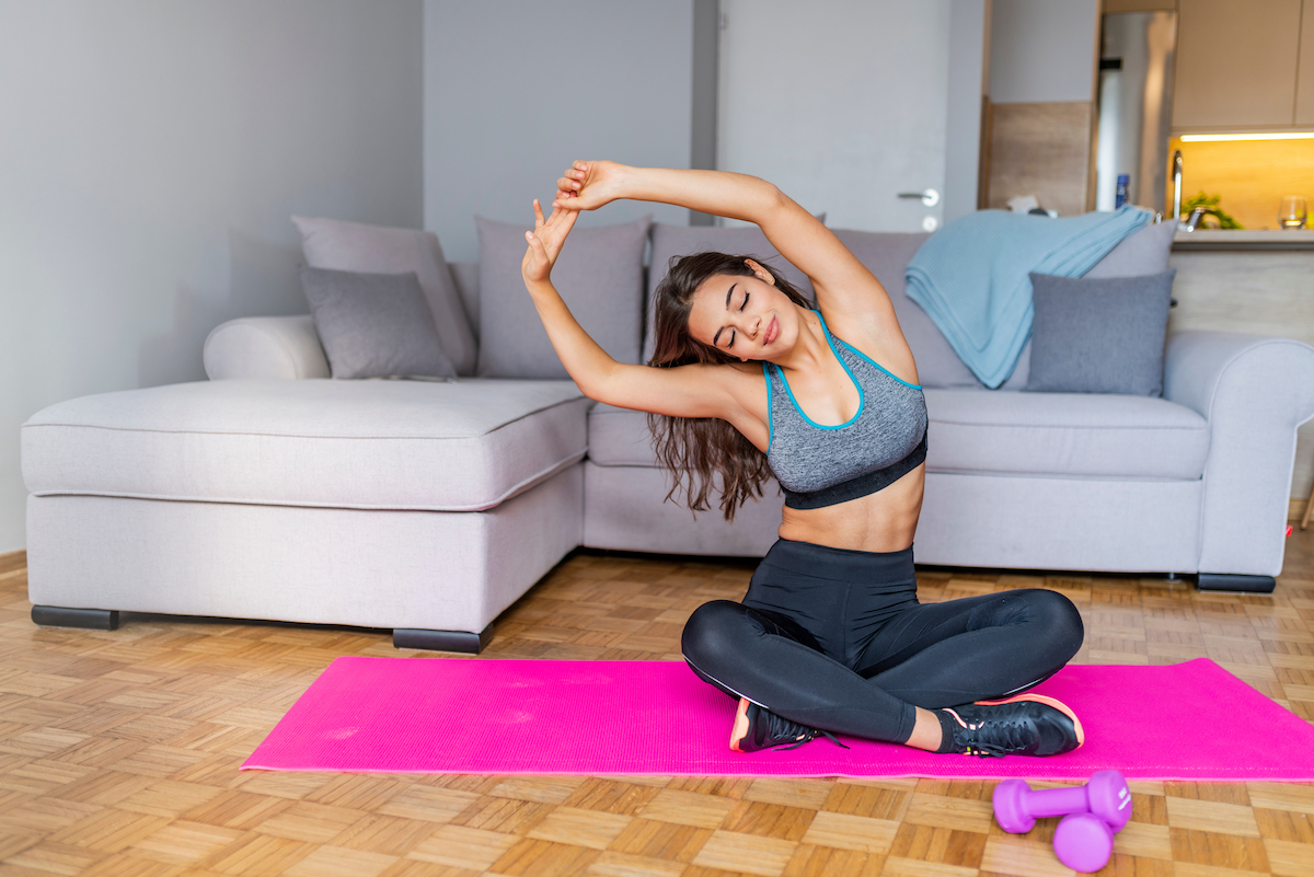 Fitness Workout, Yoga Exercise For Woman. Beautiful Girl With Fit Slim Body Doing Stretching In Morning. Sporty Female Model Exercising, Practicing Yoga At Home. Healthy Lifestyle And Wellness Concept