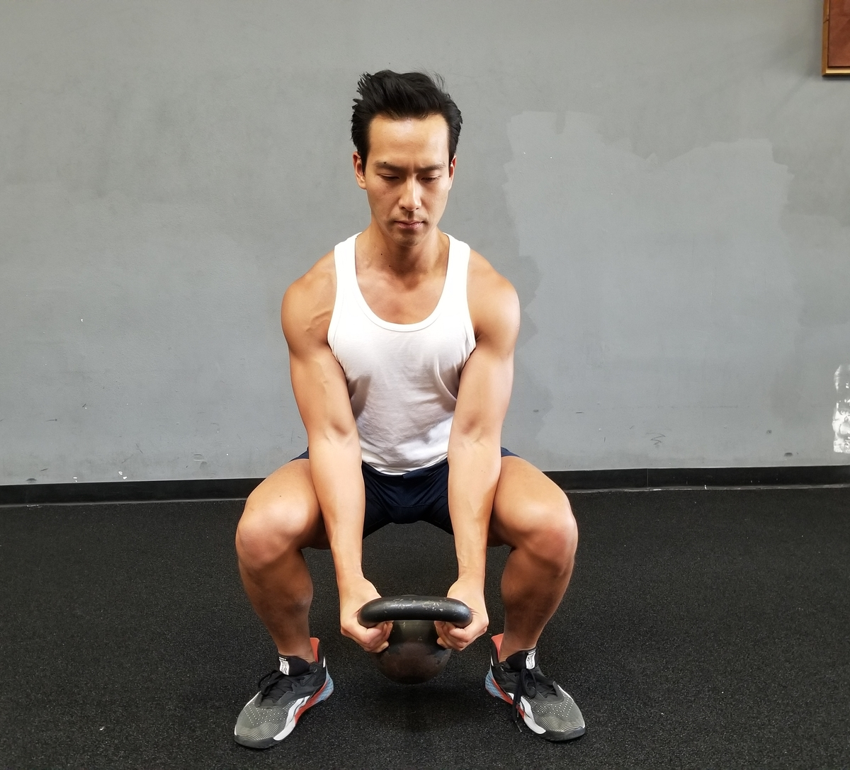 3 Kettlebell Goblet squat and reverse curl