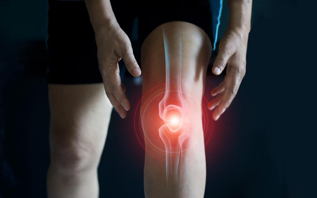 Elderly woman suffering from pain in knee