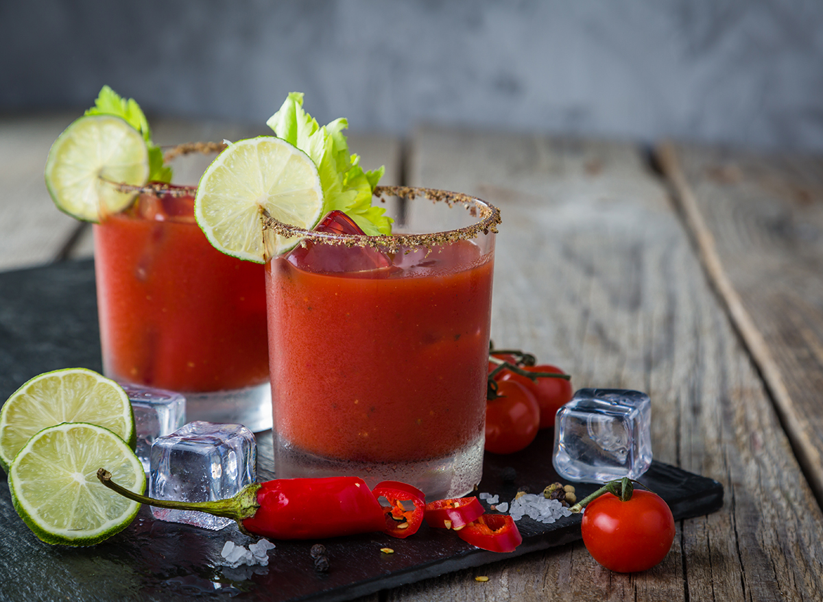 two bloody mary cocktails with lime garnish