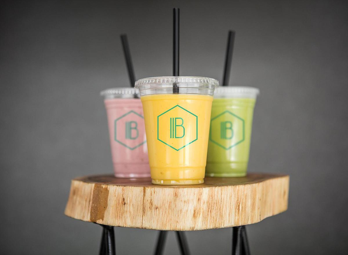 three smoothies on pedestal