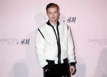 cameron monaghan in white jacket with black trim on red carpet