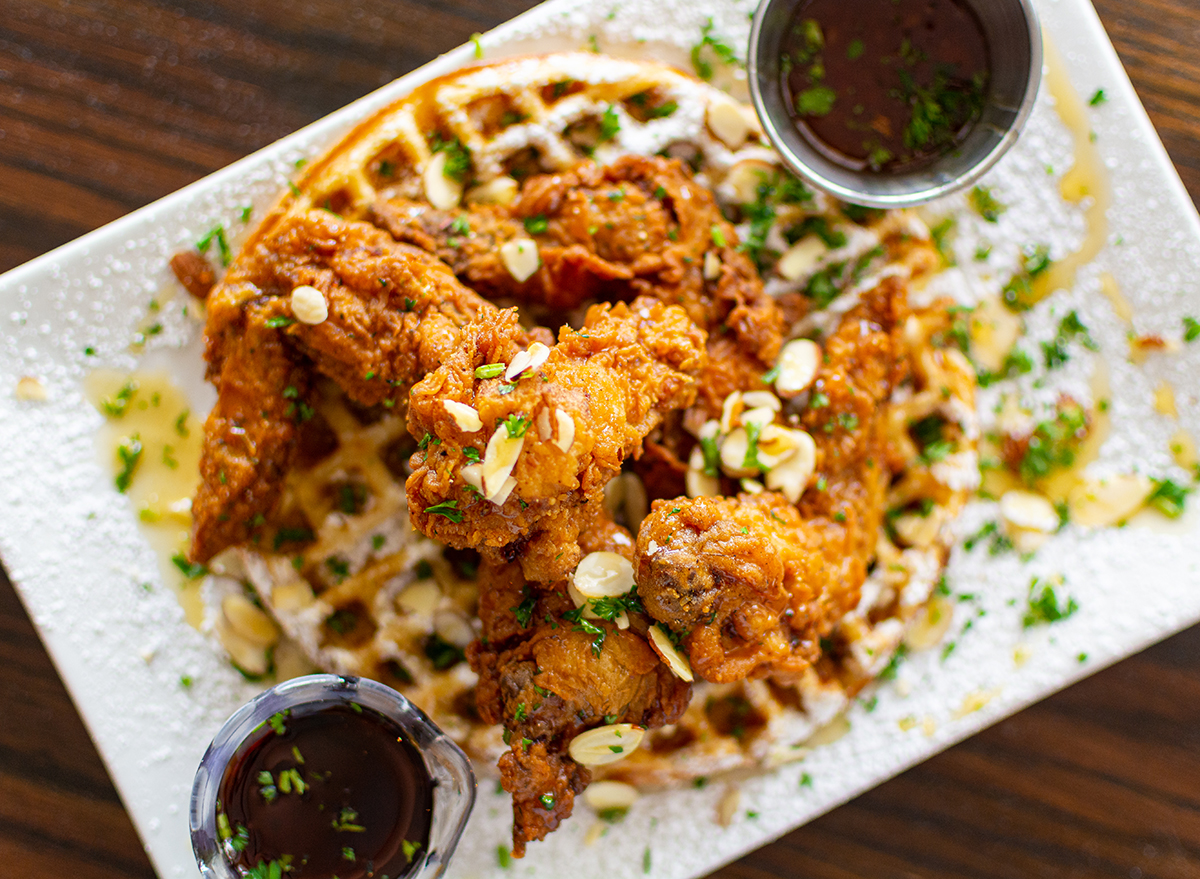 chicken and waffles topped with slivered almonds