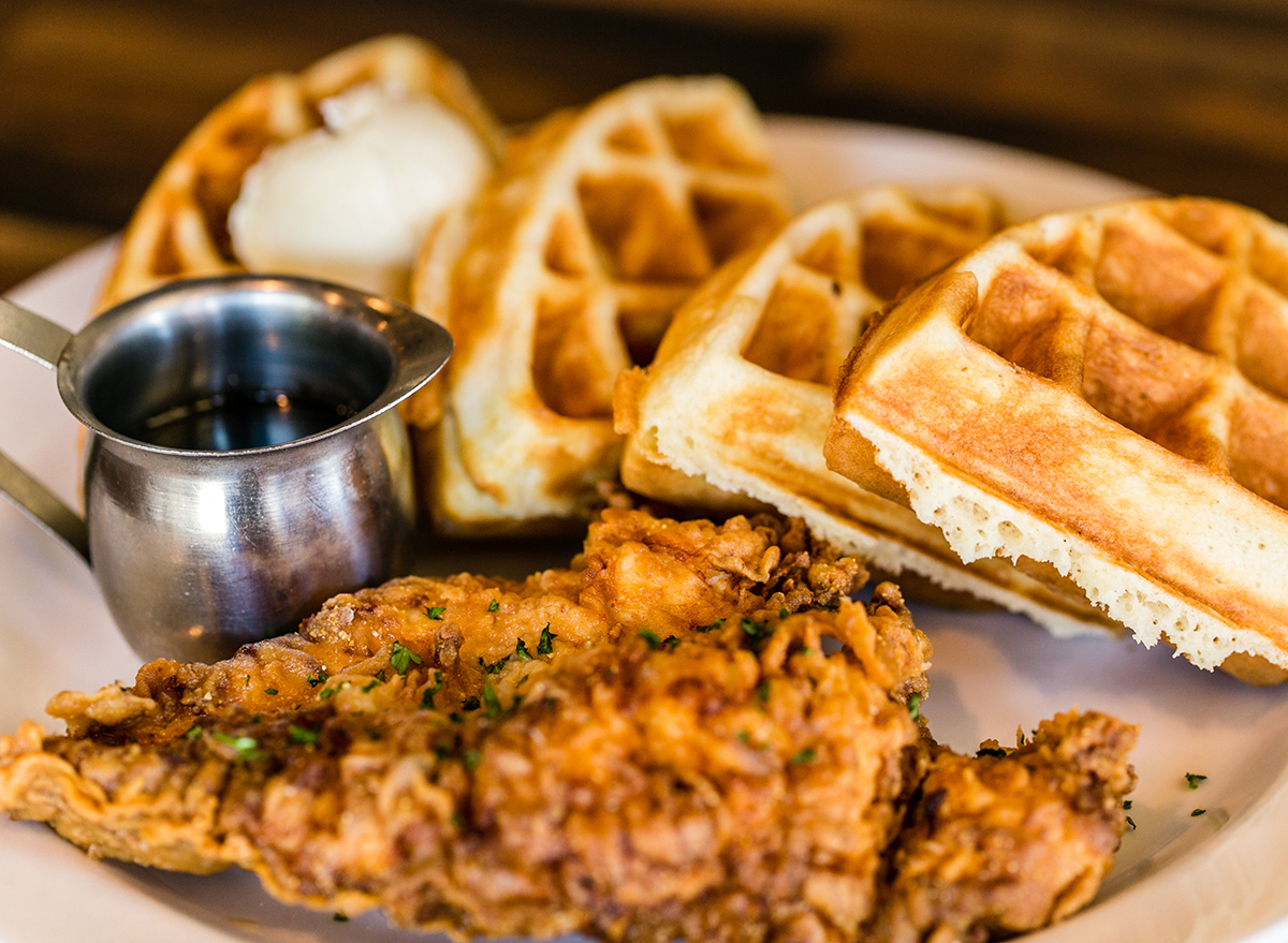 fried chicken and waffles with syrup