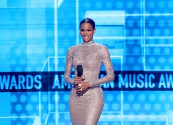 singer ciara in silver dress on stage at awards show
