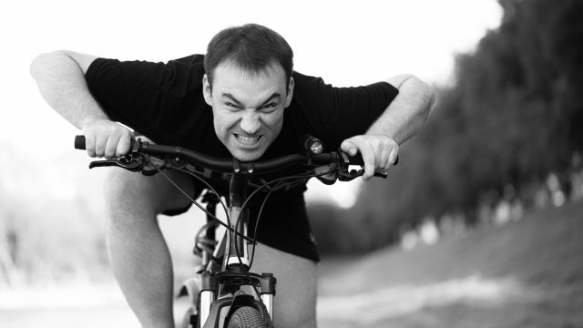 the Angry Grimacing Bicyclist Rides Bicycle Closeup