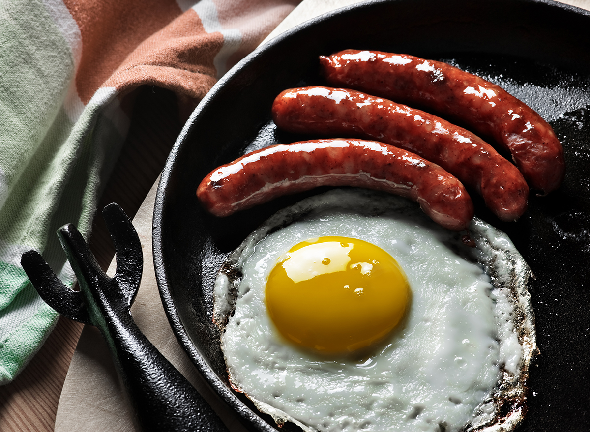 fried egg and sausage links in pan
