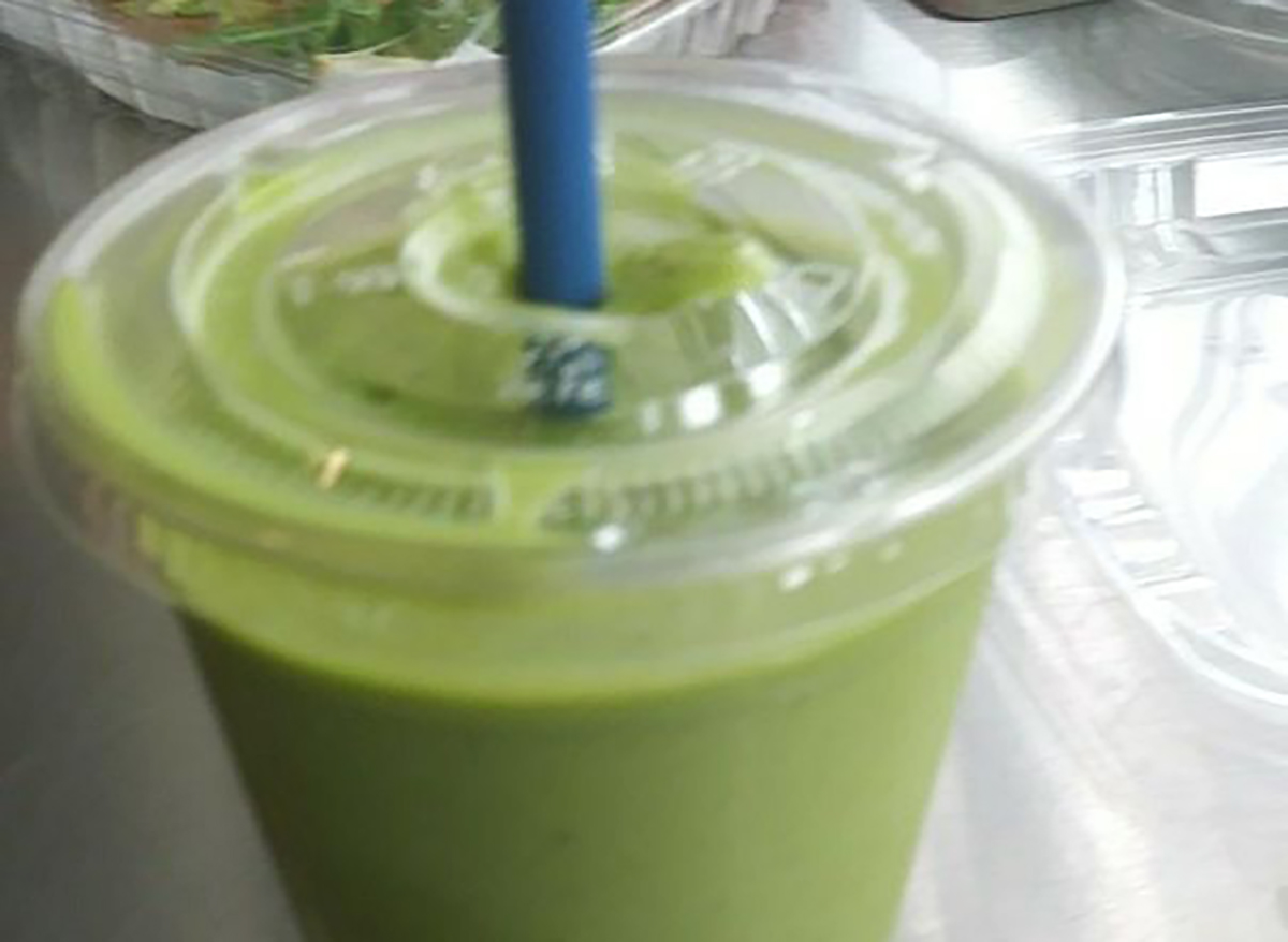 green smoothie with blue straw