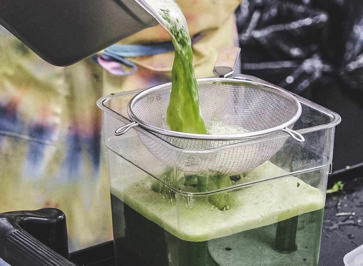 green juice being strained