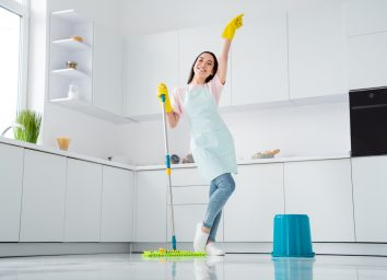 happy person cleaning her home